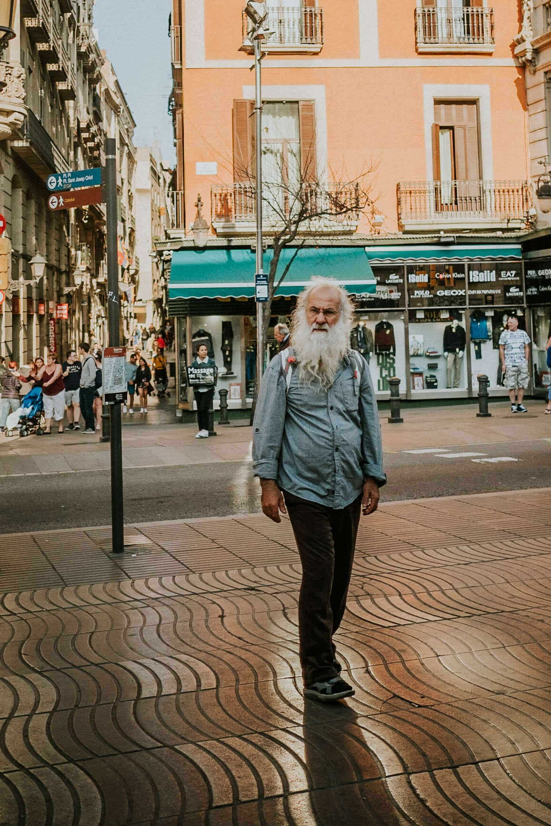 Portrait of an old bearded man on the streets of Barcelona
