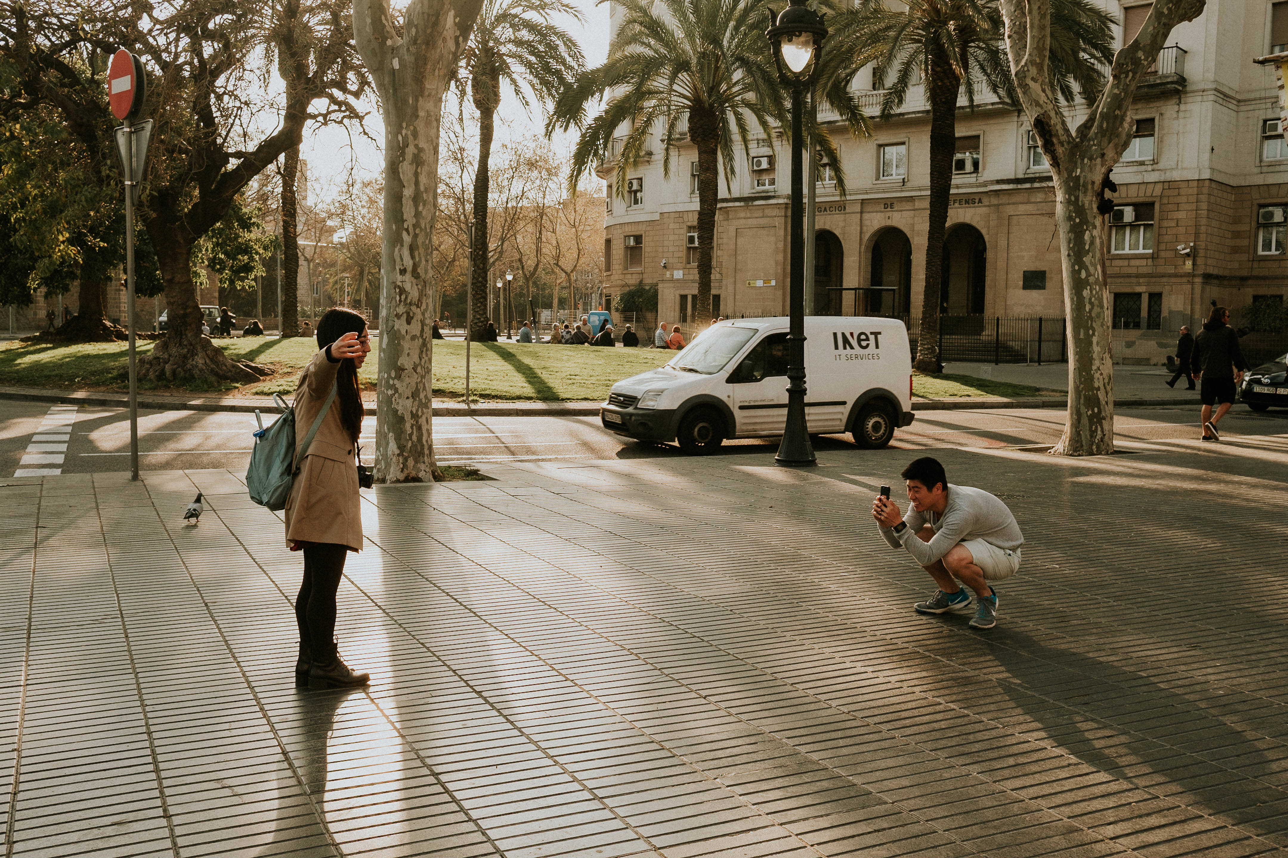A man takes a photo of a girl on Las Ramblas, Barcelona