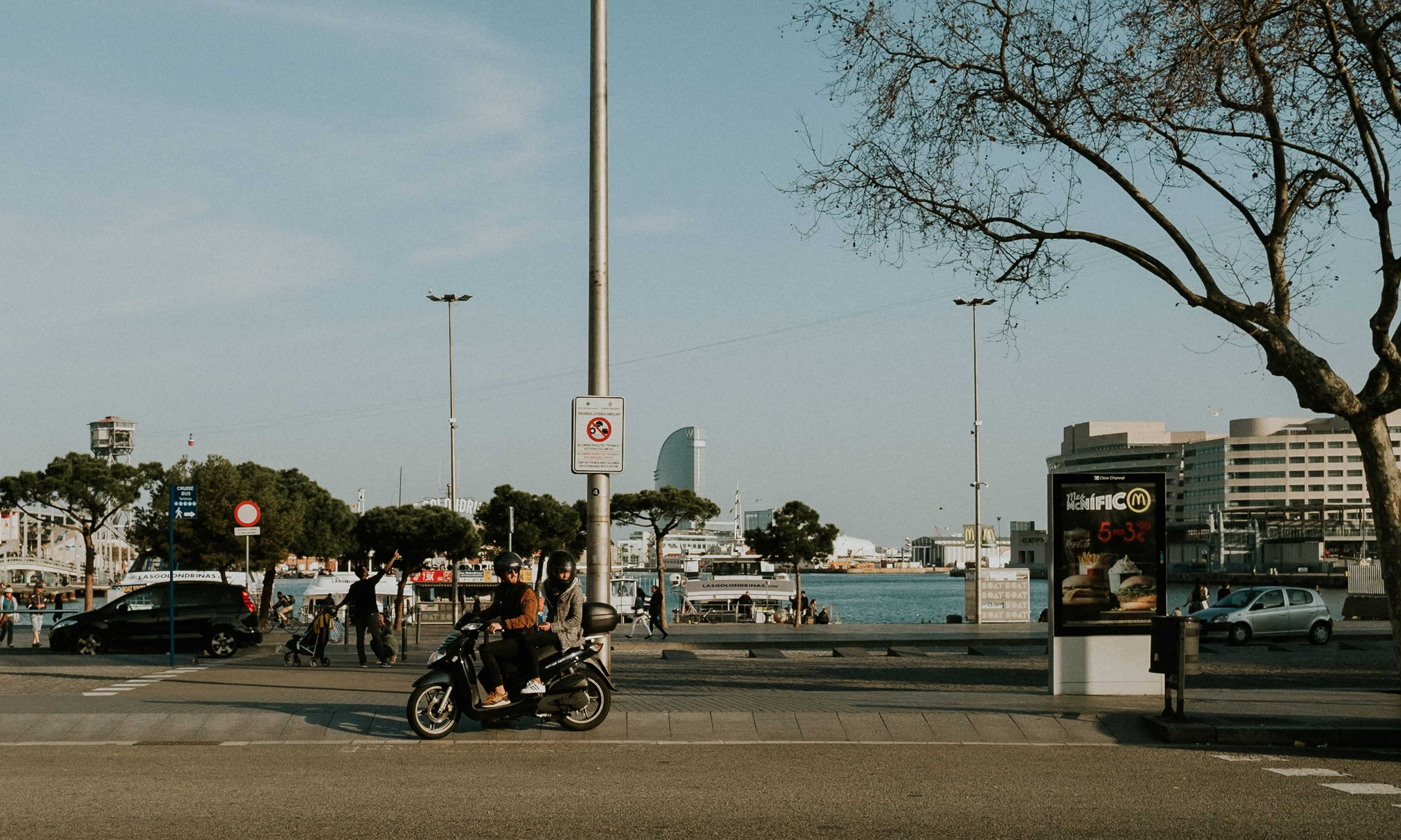 Moped with man and woman in Barcelona