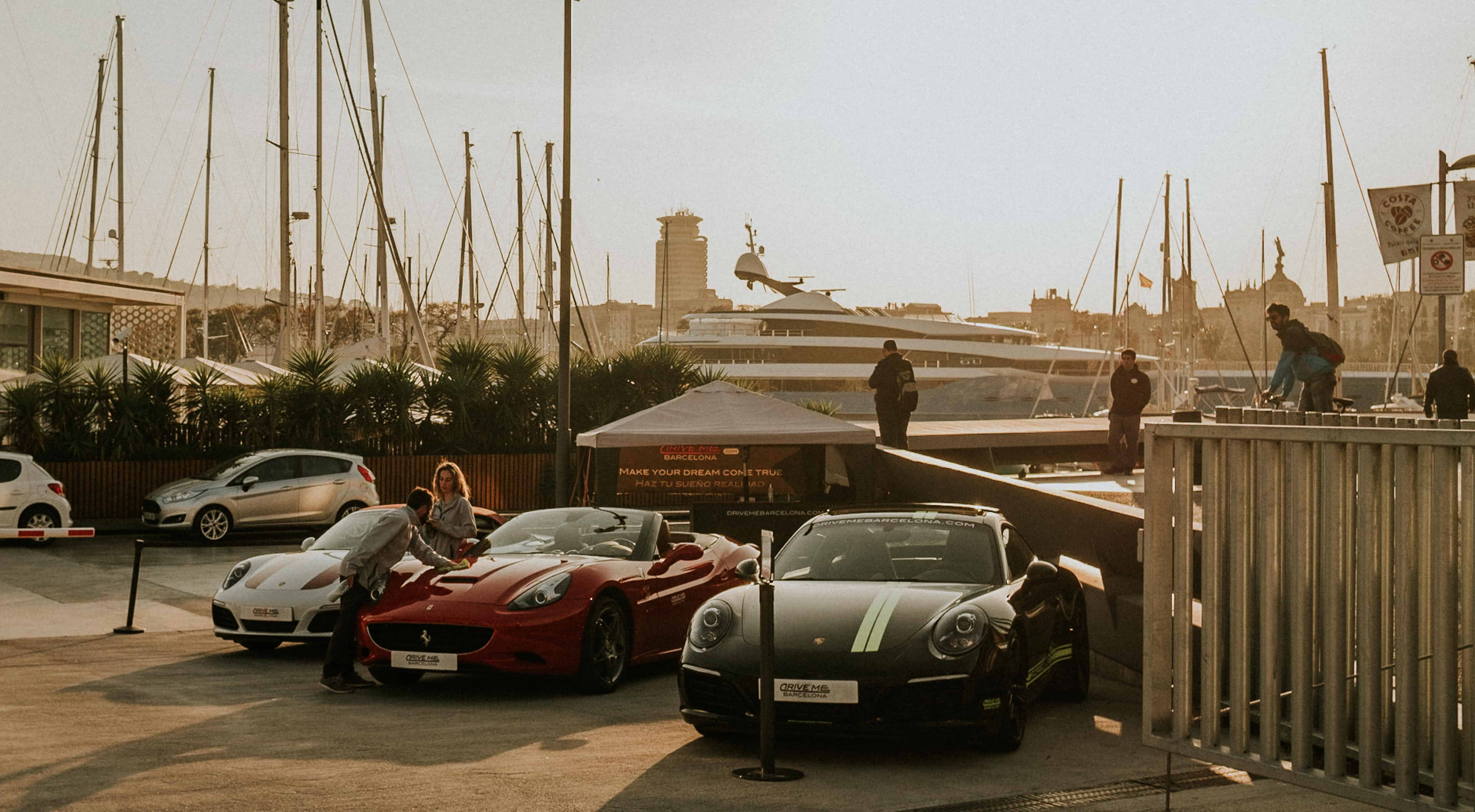 Expensive sports cars under the sunset in Barcelona