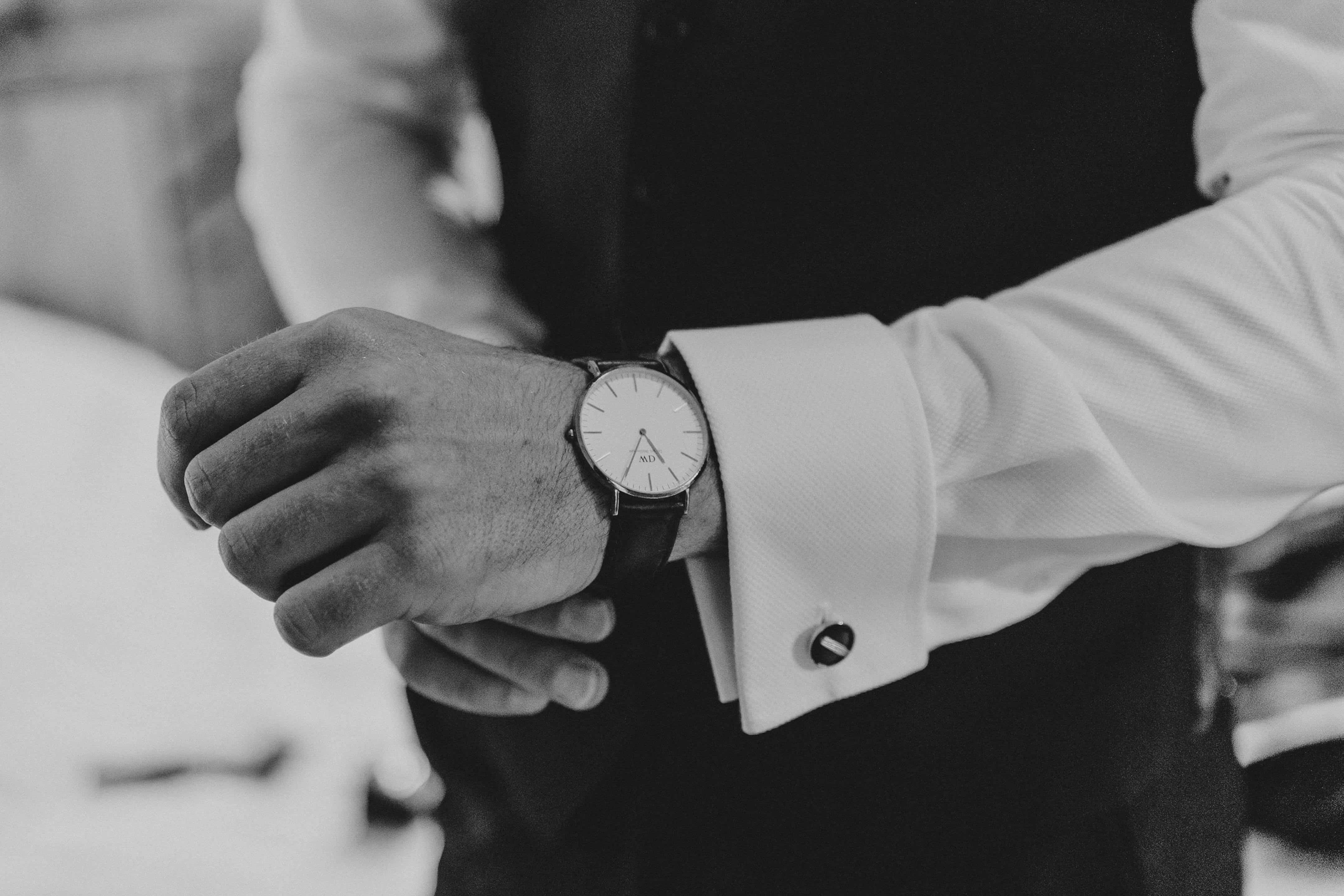 Groom checks his watch