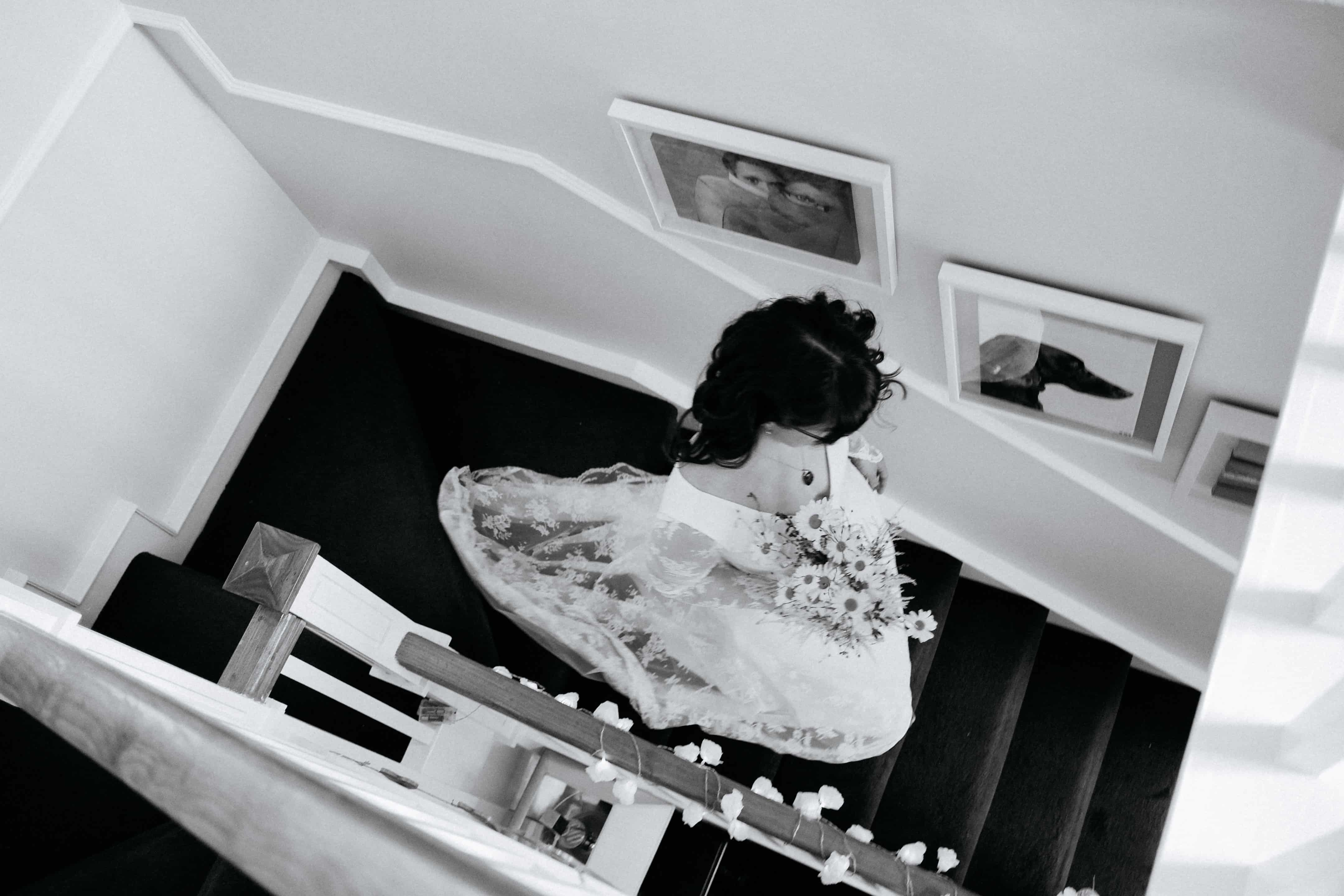 Bride walking downstairs