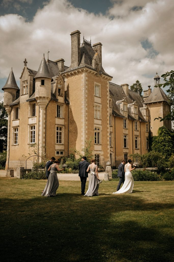 image of bridal party walk across from of Chateau St. Julien