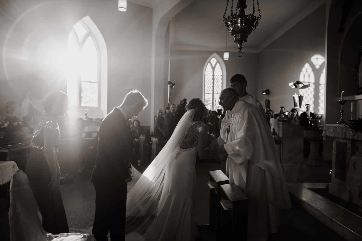 bride shakes hands with the priest