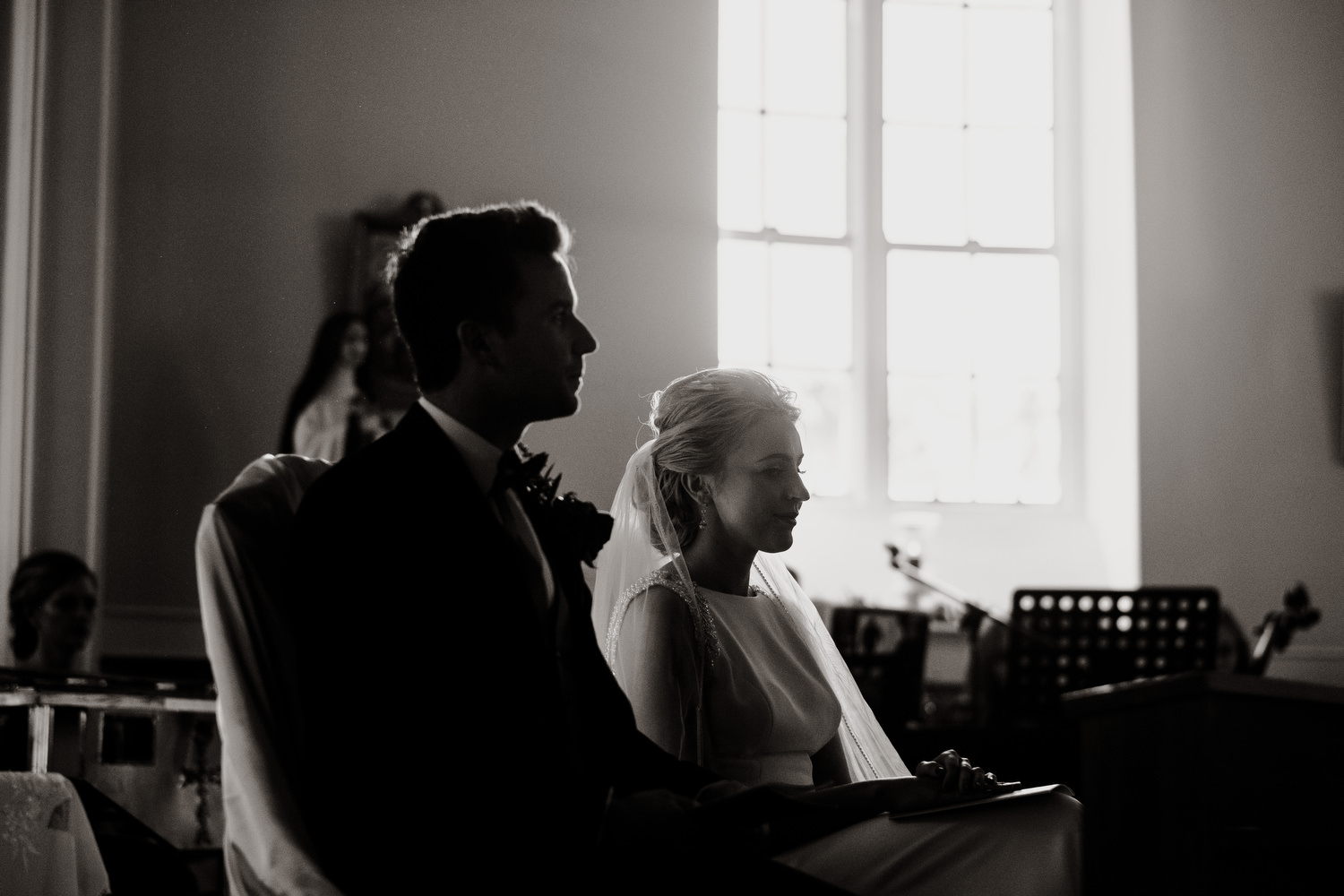 silhouette of groom and bride during wedding ceremony