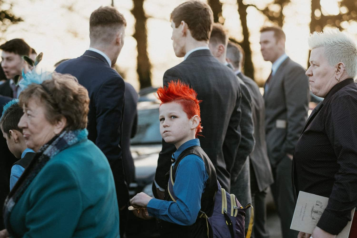 portrait of boy with red hair after wedding ceremony