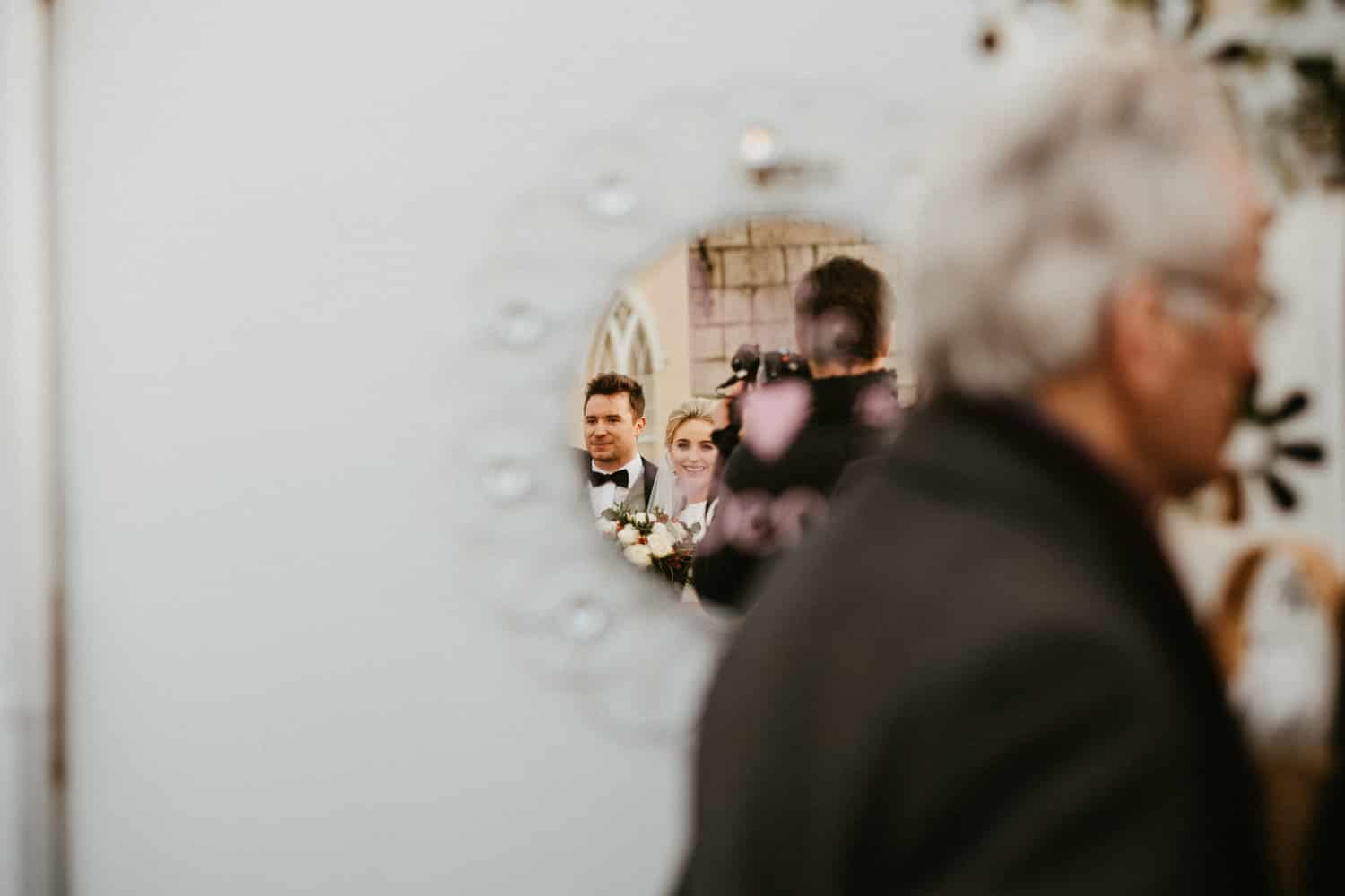 bride and groom reflection in a mirror
