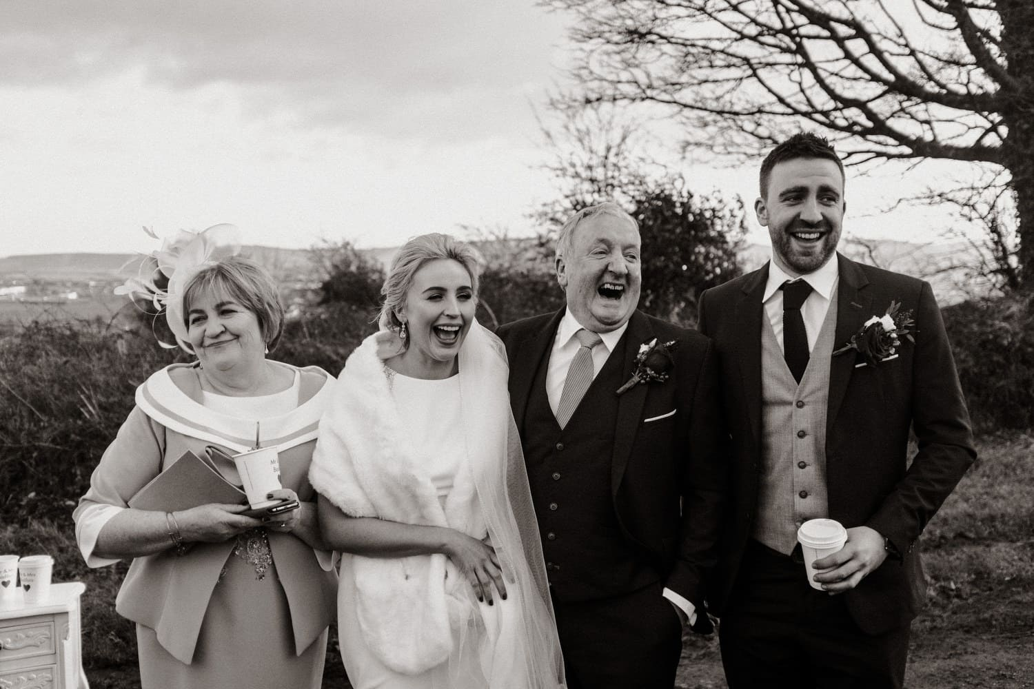 family photos with bride laughing