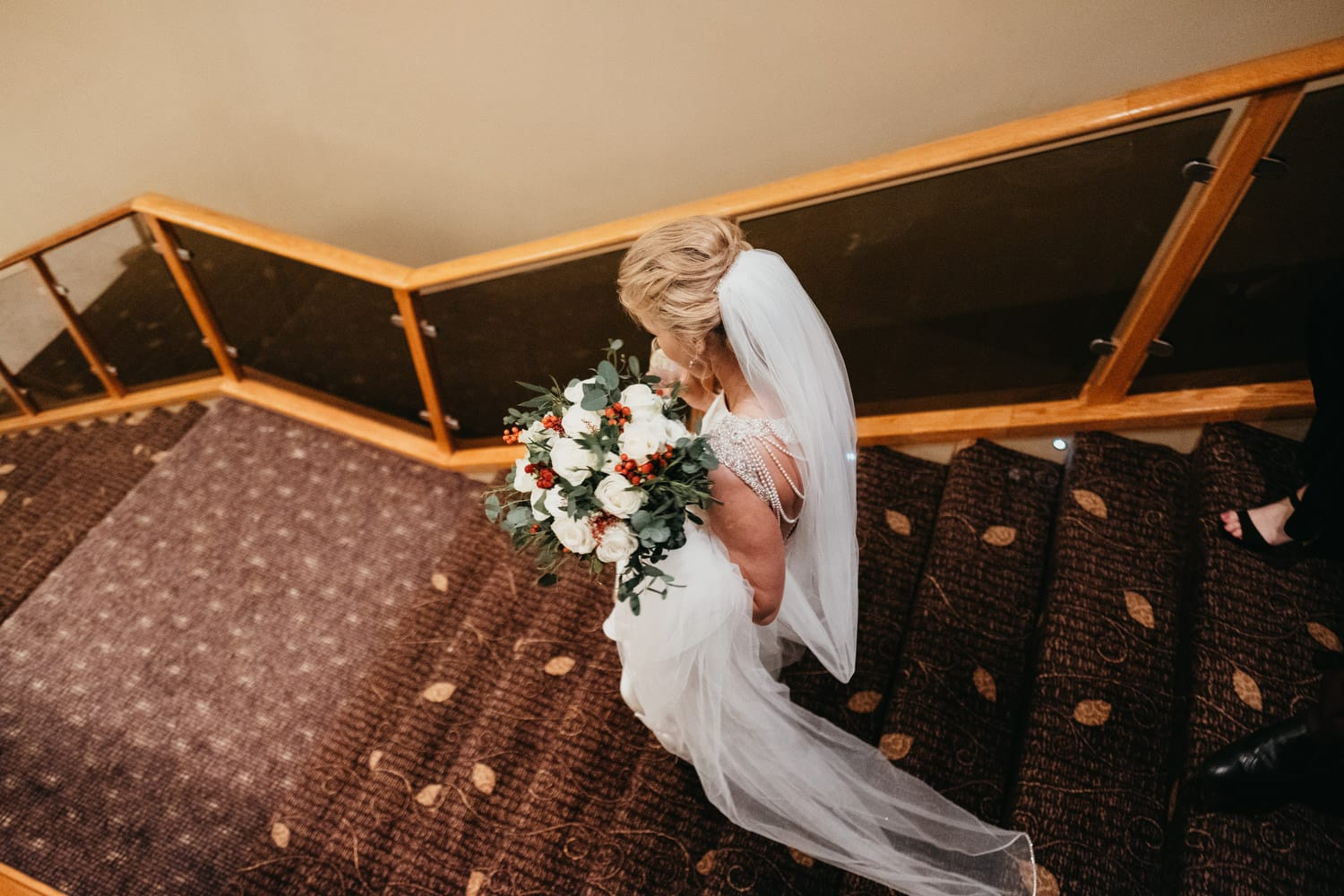 brie walking down the stairs at wedding reception