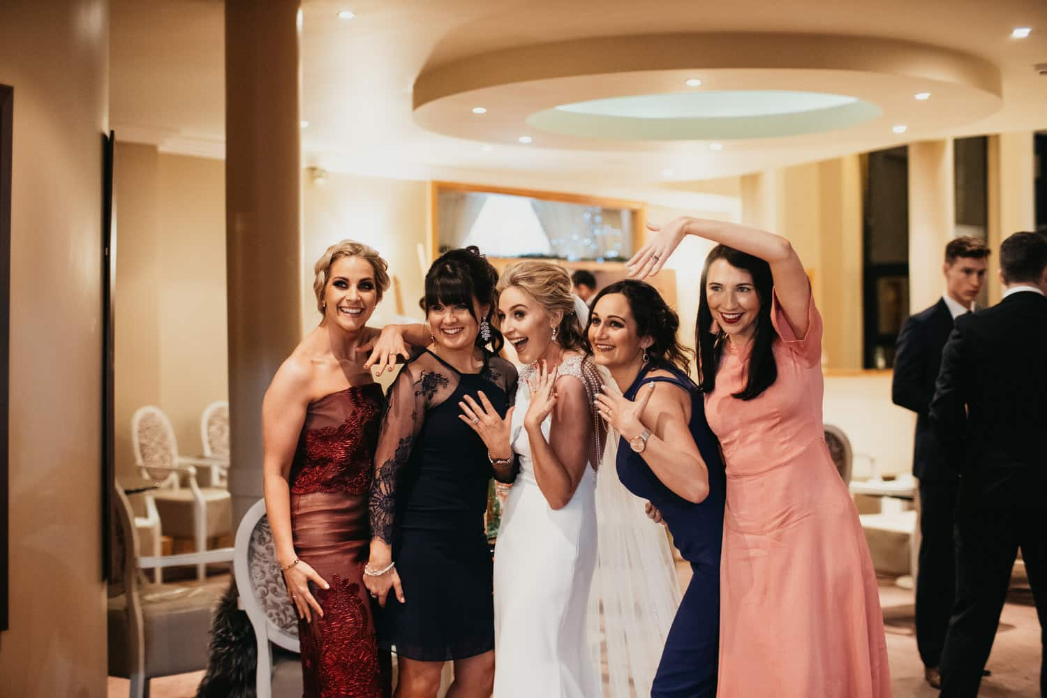 the bride takes a selfie with her friends